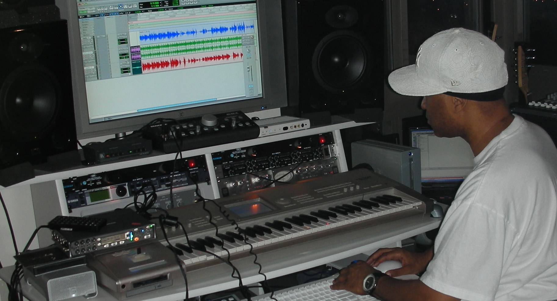 music production producer at console - Music Production Desk